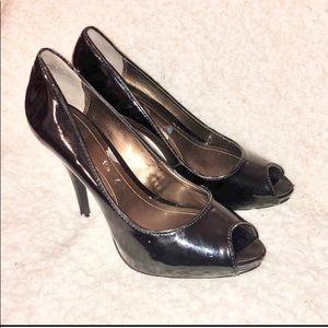 Victor Alfaro black patent leather peep toe heels.